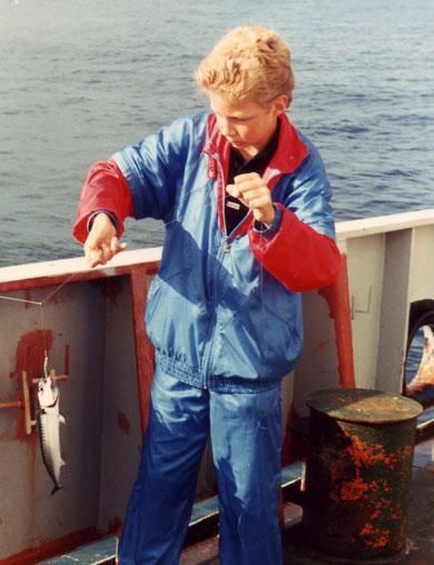 vissen aan boord bij zijn pa